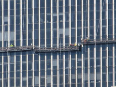 2019 Group of Window Washers on One Penn Plaza 2902 (Brechtbug) Tags: 2019 group window washers one penn plaza red number 1 light top building tower from hells kitchen clinton near times square broadway nyc 06262019 city midtown manhattan spring springtime weather dark low hanging cumulonimbus cumulus nimbus cloud hell s nemo southern view ny1 windows washer scaffold rig platform off buildings clean june