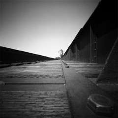 I'm stuck on the rails... (Dikal) Tags: canada quebec zeroimage2000 ilford 25iso rodinal 2018 dikal fp4 montmorency pinhole sténopé lensfree nofilter notrick nb noiretblanc blackandwhite bw mediumformat mf 120film 6x6 homemade railwaystation roadtrip