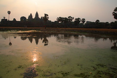 The Sun Rises Over Angkor Wat (peterkelly) Tags: digital canon 6d gadventures indochinaencompassed angkor angkorwat reflection centralstructure suryavarmanii temple waer pond sunrise dawn southeastasia asia cambodia