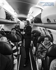 Flight Attendant Katie Helping 1st Class Passengers With Bags - B&W (AvgeekJoe) Tags: 1835mmf18dchsm a bw blackwhite blackandwhite d5300 dslr e75l erj170200lr erj175 erj175lr embraer embraererj170200lr embraererj175 embraererj175lr n633qx nikon nikond5300 sigma1835mmf18 sigma1835mmf18dchsmart sigma1835mmf18dchsmartfornikon sigmaartlens aircraft airplane aviation flightattendant jetliner lady plane stewardess woman