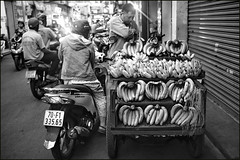 . (Out to Lunch) Tags: street binh thanh district saigon ho chi minh city vietnam alley bananas buying motorbike scooter black sales blackwhite monochrome urban fuji happyplanet asiafavorites