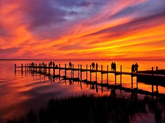 Albemarle Sound sunset (Thad Zajdowicz) Tags: sunset duck nc nature zajdowicz cellphone samsung galaxys9 snapseed water albemarlesound outerbanks obx usa people pier vivid vibrant beautiful bright outdoor northcarolina vacation clouds color orange colour silhouette reflection