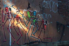 Speared (boodoo) Tags: zoomnikkor80200mm45 rawtherapee mf manualfocus zoom outdoor naturallight availablelight crownheights brooklyn mural graffiti skeletons afternoon summer haldclut agfaprecisa100