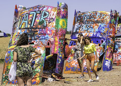 Double Fisted Painter (punahou77) Tags: cadillacranch sisters texas interstate40 nikon nikond500 art route66 spraypaint grafitti stevejordan punahou77 family strangers paint painting cadillac buried people girls roadtrip