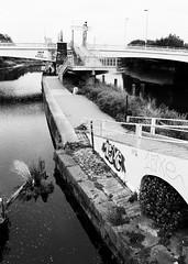 Bow Locks, London (a.pierre4840) Tags: olympus om3 zuiko 24mm f28 35mmfilm ilford ilfordhp5 hp5 hp5plus bw blackandwhite noiretblanc river canal bridge london england graffiti urban decay path
