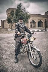 The Motorbike Rider (Roberto Pazzi Photography) Tags: portrait people travel elder man iran face asia rafsanjan culture place photography nikon street rider caravanserai cap motorbike