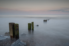 Sunset on the groynes (John Holmes (DAJH51)) Tags: youghal colour evening groynes longexposure old rocks stones sunset wavescloud weathered wood