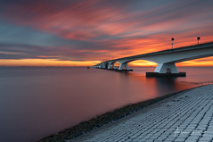 Zeeland Bridge Sunset III (Alec Lux) Tags: architecture blue bluehour bridge clouds exterior golden goldenhour haida haidafilters longexposure minimal minimalism netherlands outdoor outside sky sun sunset water zeeland