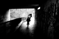 Bicycle race (Konica Big Mini) (stefankamert) Tags: bicyclerace bicycle race blur blurry blackandwhite blackwhite noiretblanc noir people film analo analogue konica bigmini bm302 35mm ilford fp4 stefankamert tunnel shadows light bw