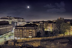 Midnight Sundbyberg (Niles Herman) Tags: night nightscape nightsky lights city urban midnight moon moonlight clouds sky buildings construction site