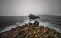 Dunmore Head II (Tore Thiis Fjeld) Tags: ireland coumeenoole dunmore head coastal landscape sandstone atlantic ocean sea le evening rocks waves gale nikkor z 1430mm f4 s wind nikon z7
