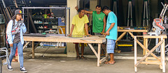 Measure Twice, Cut Once (risingthermals) Tags: philippines pilipinas filipinos pilipinos pinoys humans humanity candid street photography tropical country southeast asians everyday life scenes capture events experiences unposed natural people man men carpenters standing pedestrian woman walking calculating dimensions tape measure saw tools trade workshop store shop display case table wood bench project calculator