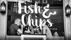 Fish and chip shop. (James-Burke) Tags: devon chipshop fishandchipshop sidmouth candid people window woman man customers