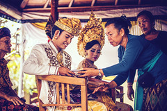 BALI, INDONESIA - APRIL 13, 2018: Newlyweds on balinese wedding ceremony. Traditional wedding. (Artem Beliaikin) Tags: editorial traditional wedding couple dress palace inside balinese culture bali religion beautiful asia asian woman hindu people man marriage decoration indonesia love bride ceremony flower groom indonesian family outdoor ubud jewellery oriental illustrativeeditorial handsome ancient travel hinduism udeng portrait sparkle adult jewelery happiness holy married happy hat hand tradition scarf