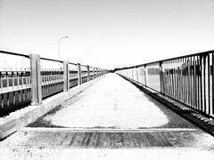 Bridge to Nowhere (MassiveKontent) Tags: bridge walkway pathway streetphotography bwphotography streetshot geometric lines bw contrast monochrome urban blackandwhite street photo montréal quebec photography asphalt concrete shadows noiretblanc blancoynegro vanishingpoint vanishinglines