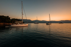 Sunset anchorage.... (Dafydd Penguin) Tags: sun sunset set evening light red orange sailboat sail boat sailing yachting yacht vessel anchor anchorage russian bay poros saronic gulf greece leica m10 16mm voigtlander super wide heliar f45
