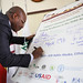 Hon. Henry Kimutai from Kenya signing support form