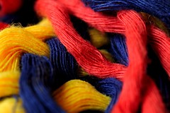 An item of cloth altered by my dog... (Puckpics) Tags: macromonday cloth fibre cotton detail red yellow blue primarycolour macro 2712019