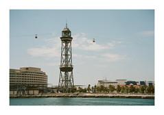 FILM - Excellent (fishyfish_arcade) Tags: 35mm analogphotography barcelona canonsureshotz135 filmphotography filmisnotdead istillshootfilm kodak portra400 analogcamera compact film cablecars tower marina