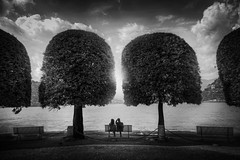 The Bench (Chrisnaton) Tags: bench sittingonabench together blackandwhite landscape como lakecomo lake clouds darknessandlight