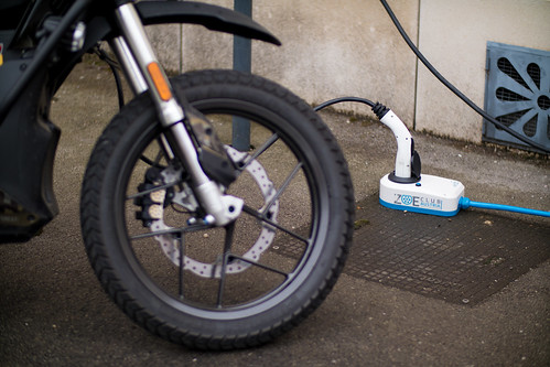 Electric dirt bike pluged into a charger