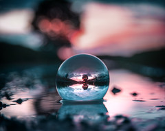 You can trust a crystal ball about as far as you can throw it.l (BasHandels) Tags: lensball nature sunset pink teal water light bokeh fade reflection