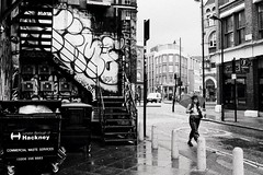 (a.pierre4840) Tags: olympus om3 zuiko 35mm f28 35mmfilm ilford ilfordhp5 hp5 hp5plus bw blackandwhite noiretblanc streetphotography rainy umbrella london graffiti urban decay