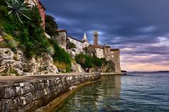 Rab lungomare, Croatia (Bokeh & Travel) Tags: rab islandofrab arba island croatia kroatien mediterranean adriatic seascape seasideview seaside sea clouds sky sunsetcolors sunsetlight sunset dalmatia lungomare