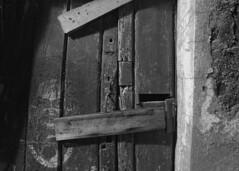 A door to nowhere (lebre.jaime) Tags: portugal beira covilhã architecture door derelict decay abandonment digital ff fullframe fx bw blackwhite noiretblanc pb pretobranco ptbw nikon d600 nikkorafs1735f28d affinity affinityphoto