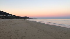 The beach at sunset, looking toward the lighthouse (which you can kind of see if you zoom in a bit) (chicadecasa) Tags: instagram australia travel fiveweeksofwinter greatoceanroad beach pacificocean ocean dusk sunset