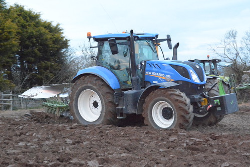 New Holland T7 210 Tractor with a Amazone Cayros 5 Furrow Plough - a