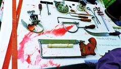 Like a surgeon, cuttin' for the very first time! (Will S.) Tags: surgery surgeon knives saw scalpel mypics warof1812 battlefieldpark stoneycreek hamilton ontario canada fakeblood