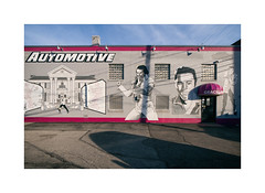 graceland automotive (simple pleasure) Tags: wall windows glassblock shadows sky powerlines chateau elvis mural awning chimney
