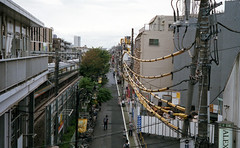 Yellow sheath (odeleapple) Tags: olympus 35rc ezuiko 42mm fujicolorsuperiapremium400 film cable sheath railway street