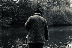 contemplating (mary.hollamby) Tags: studentphotography 200d eos canon outdoors hat thinking elderly blackandwhite white black stjamespark pond duck candid stranger london