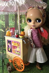 """BaD """"Umbrella"""" June 29, 2019 (Foxy Belle) Tags: doll blythe food summer park dress bench trees scene diorama barbie smoothie stand grass scrapbook paper 16 scale umbrella squirrel miniature dollhouse cowboy boots scarf head"""