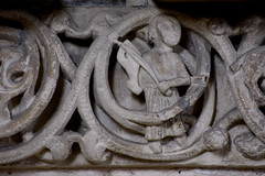 Münster, Westfalen, Paulusdom, Paradies, fries, west side:  musician among the foliage (groenling) Tags: münster westfalen dom paulusdom nordrhein nrw cathedral germany de deutschland paradies entry eingang fries friese stone carving stonecarving stein fiddle viola bratsche geige