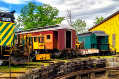 Oldtimer meetup at the roundhouse (FotoFloridian) Tags: train railroadtrack transportation locomotive travel station railroadyardoutdoors railroadcar industry machinery yellow old freighttransportation green red clouds roundtable sony alpha new hampshire northconway a6000