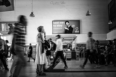 best.way.to.stay (grizzleur) Tags: stay blur motion motionblur interest wonder question questions ad ads advert advertisement woman lady interaction interacting trainstation frozen movement movements street candid photography bw mono monochrome monochromatic ricoh ricohgrii 28mm slow shutter