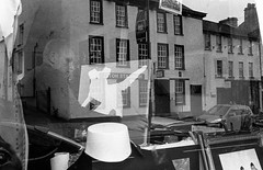 How much is that doggy in the window? (Mano Green) Tags: woman artist painting paints canvas art painter dog window reflections street person working creativity kendal cumbria england uk september autumn 2016 canon eos 300 40mm lens ilford hp5 400 35mm film black white ilfosol s epson perfection v550 candid monochrome