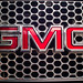 Close-up of GMC logo on a car