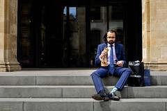 Odd Socks (Silver Machine) Tags: oxford oxfordshire streetphotography street streetportrait candid man sitting lunch glasses suit socks steps fujifilm fujifilmxt10 fujinonxf35mmf2rwr