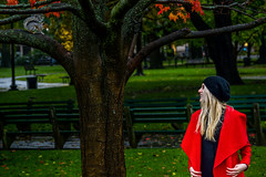 Allyn and the Squirrel (TheseusPhoto) Tags: girl female woman pretty blonde beautiful lovely pose portrait portraiture model modeling fashion light artportrait artistic fineartportrait elegantfashion glamour nature fun silly jacket smile laugh squirrel moment funny red fashionable leaves tree autumn