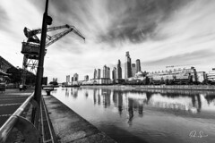 City reflection (Paio S.) Tags: downtown bw blackandwhite skyline monochrome building port cranes landscape city riber sky clouds reflections
