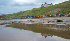 Whitby Seafront (daveseargeant) Tags: leica x typ 113 whitby beach sand coast pool seaside water sea hotel reflection north yorkshire colour cabins wooden