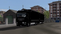 ets2_20190629_155525_00 (Kocaa_009) Tags: man mantrucks mantgx tgx tgxeuro5 tandem krone kronetrailers bdf black blackline asphalt city garage parking shadow sky cloud lights hella goodyear