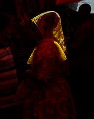In the Spice Market - Stonetown, Zanzibar (TravelsWithDan) Tags: woman muslim covered yellow sunight market city urban spicemarket stonetown zanzibar tanzania africa southernhemisphere canong3x candid streetphotography