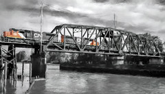 Heading North (beelzebub2011) Tags: canada britishcolumbia richmond fraserriver train trainbridge bw monochrome selectivecolor