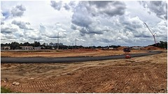 Marketplace Terrell Mill Construction Site   Marietta, Georgia (steveartist) Tags: clouds scatteredclouds snapseed sonydscwx220 stevefrenkel constructionsite soil crane utilitywires panorama marketplaceterrellmill buildings trees