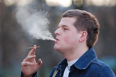 Anton D. (Pavels Dunaicevs) Tags: man guy male student smoker smoking smoke cigarette evening riga latvia nikon d50 180mm portrait bokeh nikkor hand holding shirt young spring